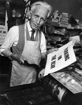 Philip T. Timms at printing press, near his 94th birthday