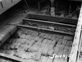 Last cargo of raw sugar: bags of sugar in hold of M/V Suva [?]