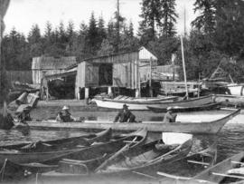 [Canoes and a boathouse at Brockton Point]