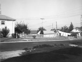 Slocan Street, west side, between 5th Avenue and lane north - view west