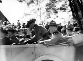 [R.C.M.P. in car during visit of King George VI and Queen Elizabeth]