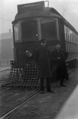 [Driver and conductor in front of a Davie streetcar No. 33]