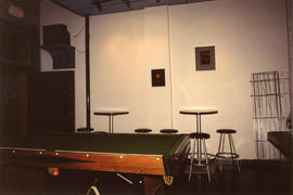 Pool table and chairs inside Columbia Hotel at 303 Columbia Street