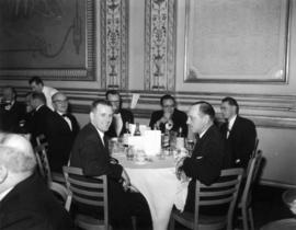 [Unidentified men at restaurant table]
