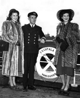 [Margaret Brain (Miss P.N.E. 1948), Captain E.M. Sheppard and unidentified women aboard S.S. &quo...