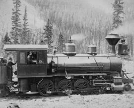 Locomotive at field, C.P.R., Rocky Mountains