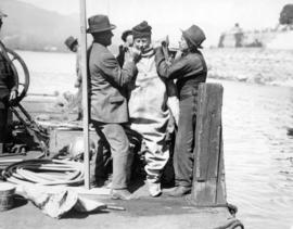 [Waterworks diving crew prepare Mayor L.D. Taylor for First Narrows dive]