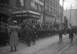 Duke of Devonshire inspecting R.C.M.P. on arrival [600 block West Cordova Street]