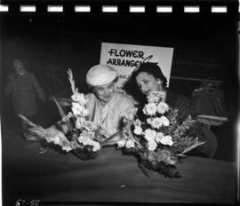 Women with entries in flower arrangement contest in 1957 P.N.E. Home Arts show