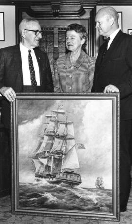 "[Major George Nicholson, Inez Mitchell and L.J. Wallace with a painting of ""Discovery"" ..."