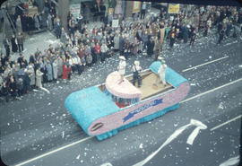 43rd Grey Cup Parade, on Granville Street, Saskatchewan Wheat float and spectators