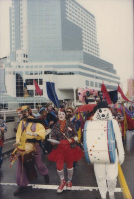 Group wearing costumes march in the Beaux Gestes parade