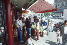 People shopping at grocery on 200 block Keefer Street