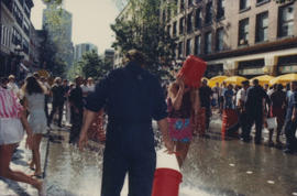 """Giant Fire Drill"" participants carrying buckets of water"