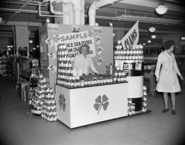 [Clover Leaf canned clams sampling display at Woodward's]
