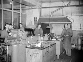 [Mechanics at work at Boultbee Ltd., auto garage, 999 Seymour Street]