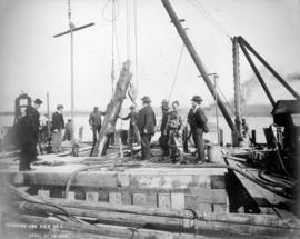 Removing Log [from] Pier No.3