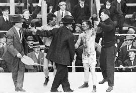 [A boxing match between Ray Campbell and Dick Hyland]