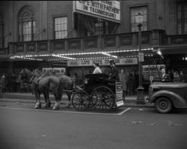 "[Actor in costume in a horse and carriage outside the Strand Theatre promoting ""Life with Fa..."