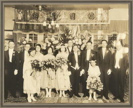 Nellie Ho and her husband with their wedding party