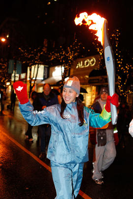 Torchbearer 96 Andrea Holmes carries the flame in Vancouver, BC