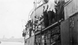 Passengers and crew at the rails of the Komagata Maru