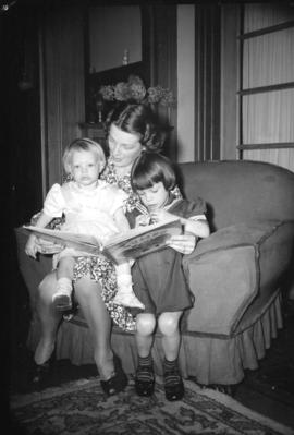 [Mother reading to her children]