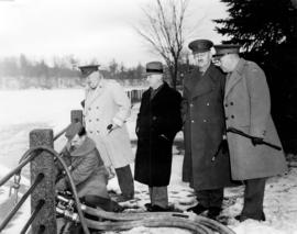 [Major J.P. Mackenzie and others inspecting fire equipment]