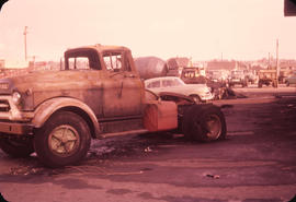 [Truck damaged during fire at Pacific GMC at the corner of Nanaimo Street and Broadway]