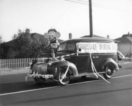 [A car advertising Kerrisdale Sporting Goods during a parade in Kerrisdale]