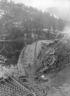 Lake Buntzen tunnel enlargement [showing] tunnel camps and measuring weir at portal