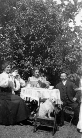 Wilgand family having tea outdoors at Bedwell Bay