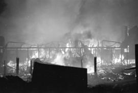 Denman Arena fire with lamppost and street sign in the foreground