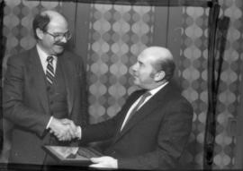 Peter Paul Saunders receives award from Mike Harcourt