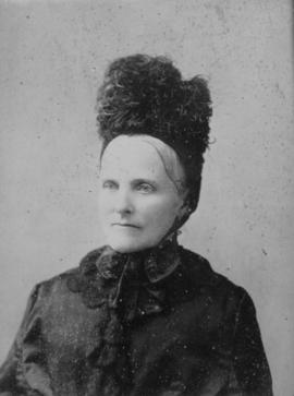 [Head and shoulders studio portrait of older woman with plume hat]