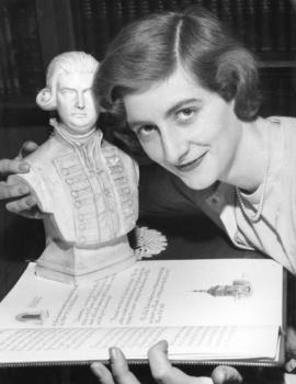 [Miss Diana Denny with a statuette to be presented to the Council of King's Lynn to commemor...