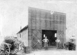 [Exterior of a blacksmith shop]