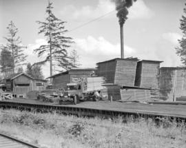 [Western Red Cedar Mills Limited truck loaded with lumber]