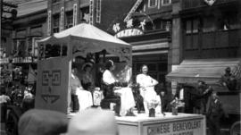 A Chinese parade, showing float for the Chinese Benevolent Association