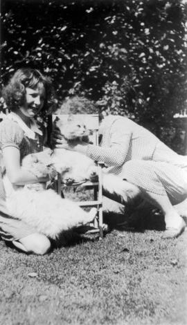 [Girl, Emily Matthews, and cats Jack and Jill in 1158 Arbutus Street garden]