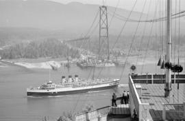 [View from the Prospect Point signal station of a ship passing under the Lions Gate Bridge under ...