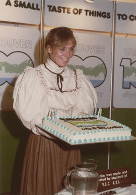Gail McCormick holding cake at the Future Fair