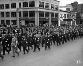 ARP wardens marching in World War II parade on Burrard Street