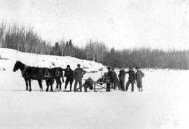 Men with horses and equipment in the snow