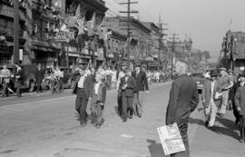 [Crowds on Pender Street celebrating VJ Day]