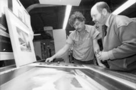 Unidentified man and Toni Onley examine his Centennial Art Series Print at Agency Press