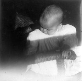 [Theodore Taylor holding on to arm of chair at age] 1 and one half y[ea]r