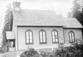 [Exterior of the first St. James Church near the foot of Main Street]