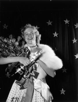 Miss P.N.E., Glenda Sjoberg, posing with roses and trophy
