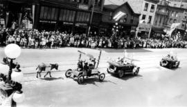 [Decorated automobiles in the Dominion Day Parade]